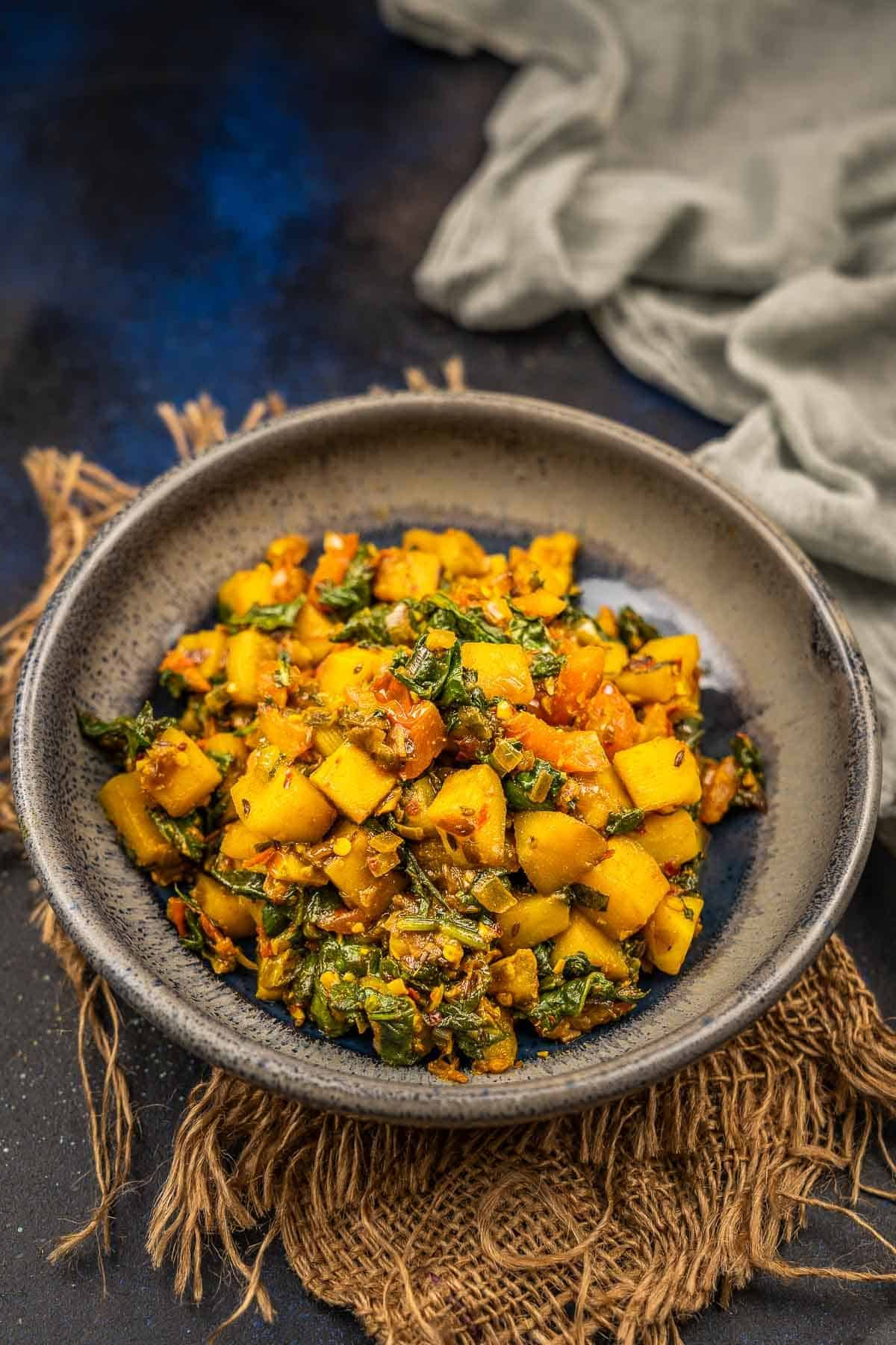 Aloo palak served in a bowl.