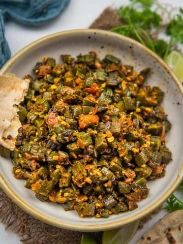 Bhindi bhaji (bhindi chi bhaji) is a Maharashtrian style okra stir fry. This vegan and gluten-free sabji comes together in under 30 minutes and is super easy and simple to make.