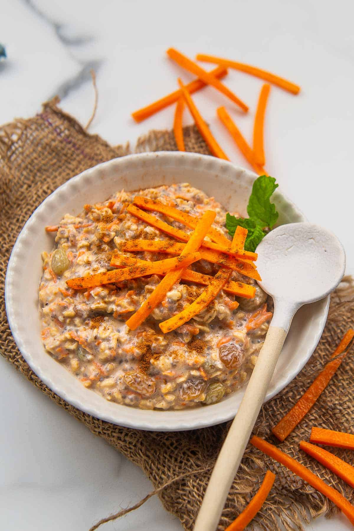 Carrot cake overnight oats served in a bowl.