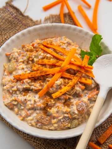 Loaded with grated carrots, raisins, and cinnamon these sweet and creamy carrot cake overnight oats taste like cake for breakfast! These take 5 minutes to come together and can be meal prepped for the entire week (vegan and gluten-free).