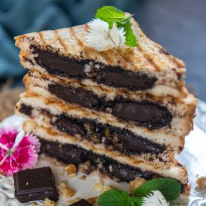 Make your favorite cafe-style chocolate sandwich at home using just 5 ingredients in 10 minutes. This dessert sandwich is a must-try recipe for all chocolate lovers. Here is how to make it.