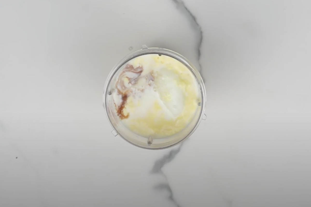 Chilled custard, frozen milk, sugar and vanilla extract added to the blender.