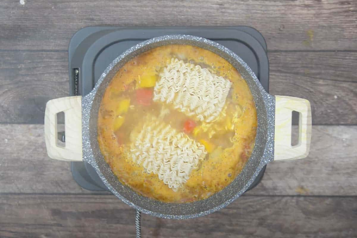 Maggi along with tastemaker added to the skillet.