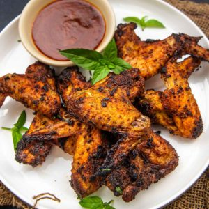 Made using just 3 ingredients, these Wingstop copycat juicy and crispy cajun wings are going to be a sure-shot hit at your next house party! Make them in an oven or an air fryer.