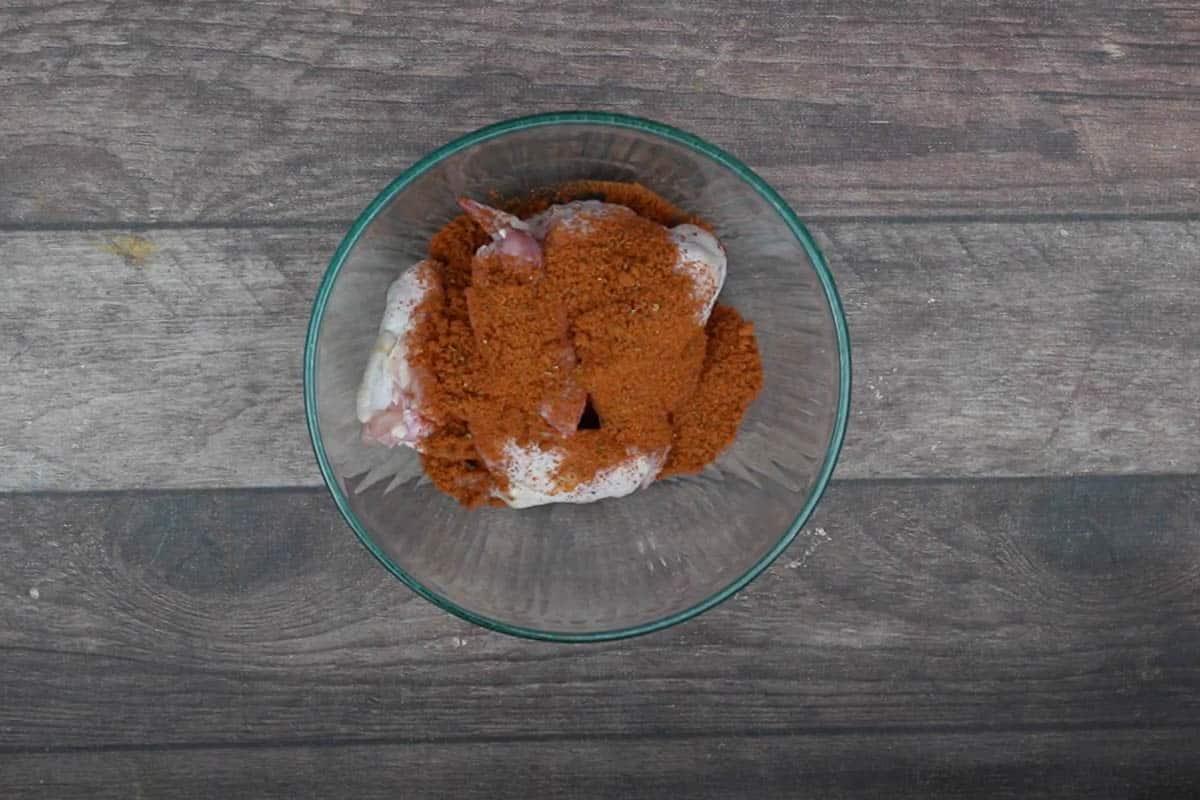 Cajun seasoning added to the bowl.