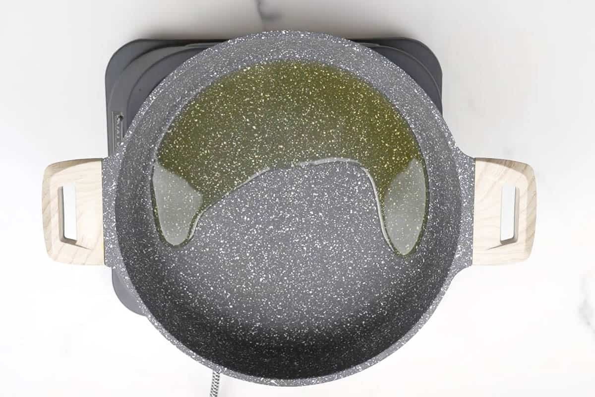 Oil heating in a skillet.
