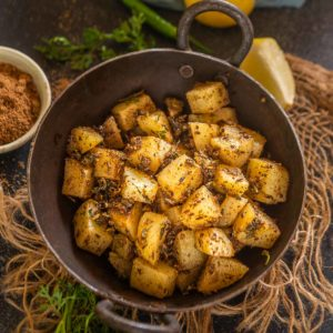 Rajasthani Jaiphali aloo is a potato stir fry made by cooking potato chunks with ground nutmeg. Serve it with roti or dal rice for a hearty Indian meal.