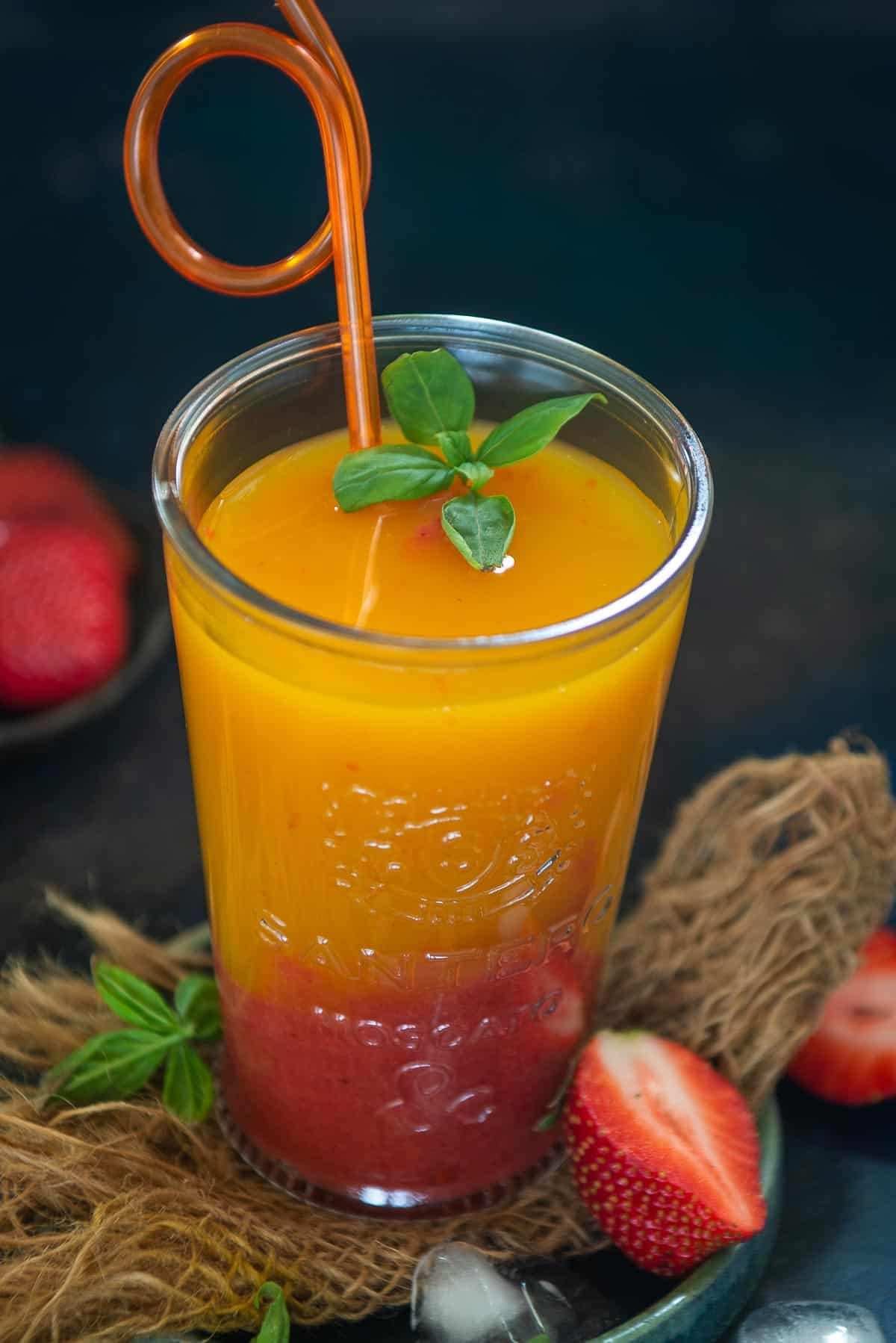 Mango strawberry surprise served in a glass.
