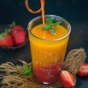 Mango strawberry sunrise is a refreshing summer drink that comes together in just a minute using 3 ingredients. This sweet, and fruity beverage is perfect to make for get-togethers or potluck parties. Here is how to make it.