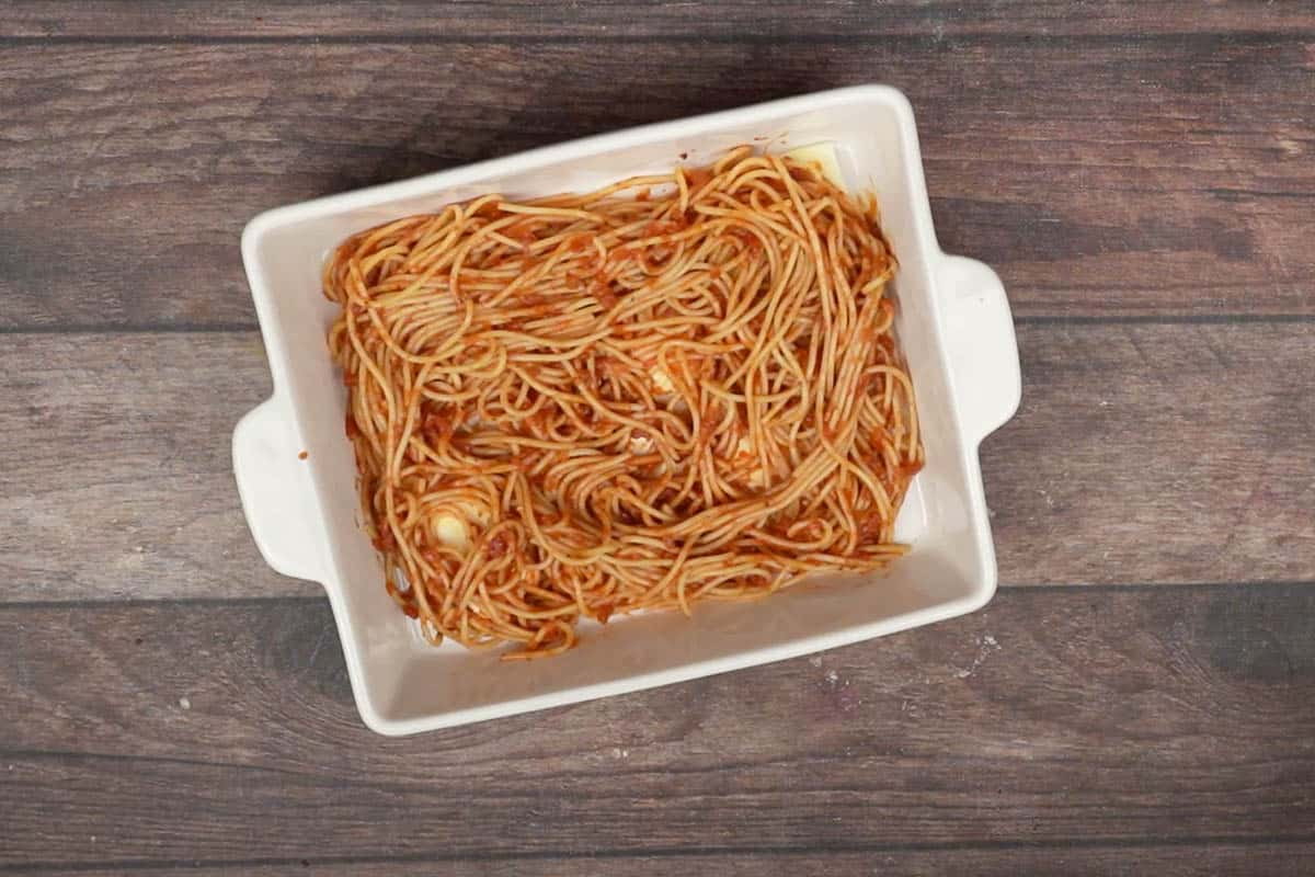 half of the spaghetti spread on the tray.