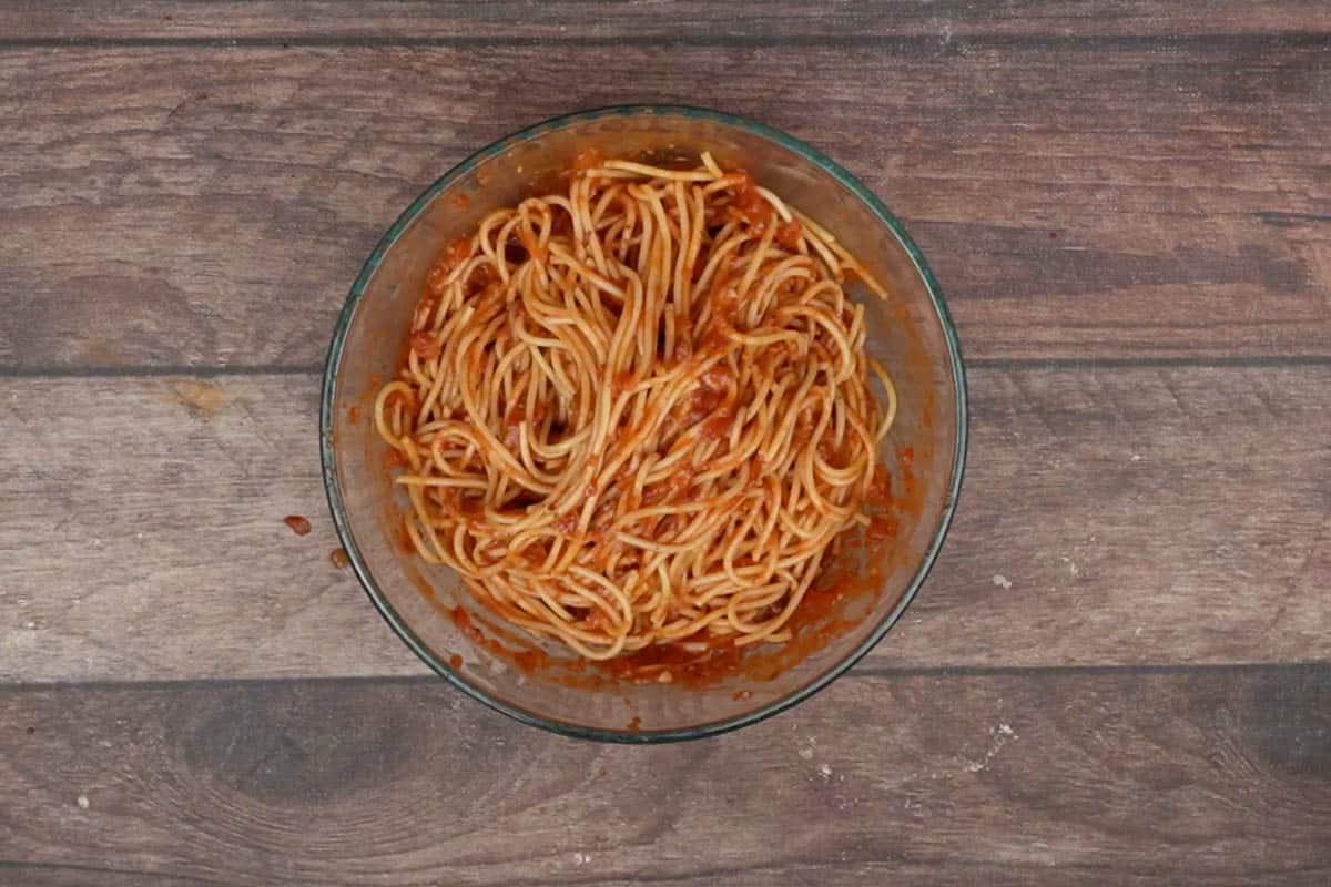 Spaghetti mixed with remaining marinara sauce.