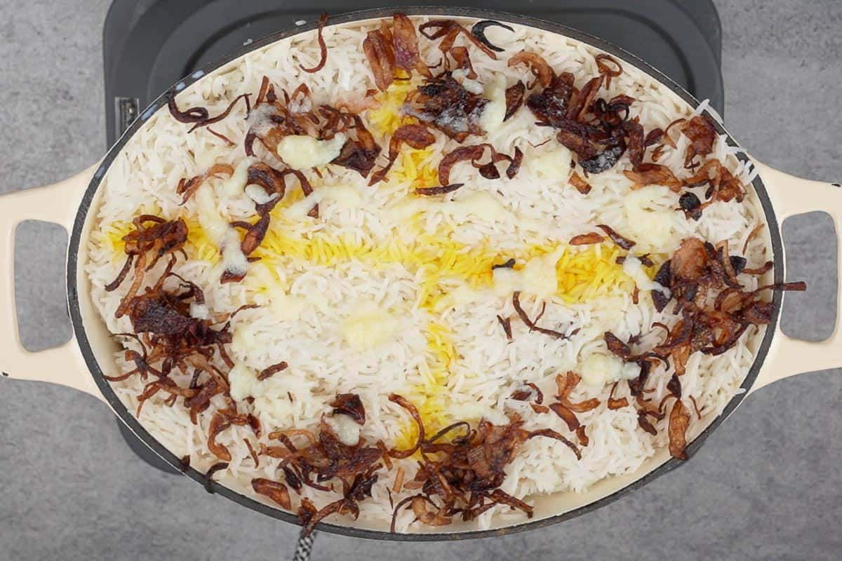 Topped with milk, saffron soaked in water, fried onions and ghee.