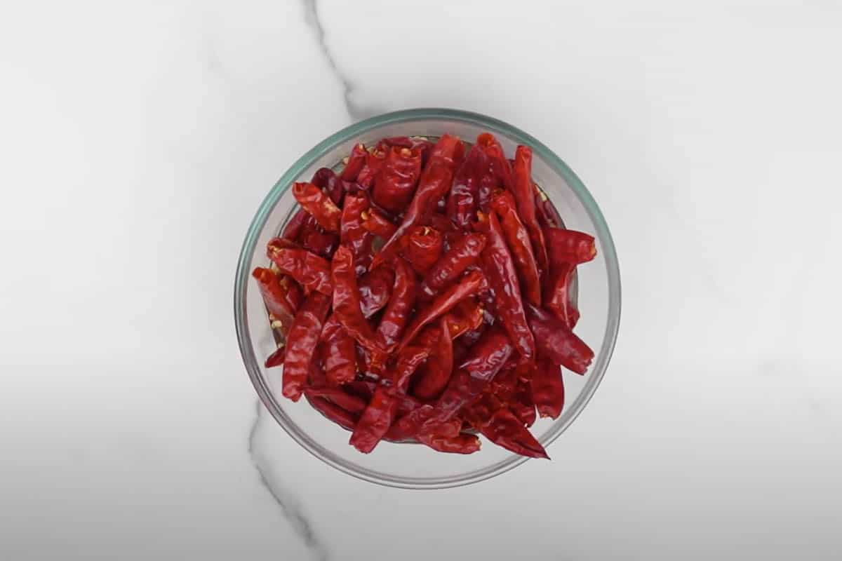 Dried red chilies soaked in water.