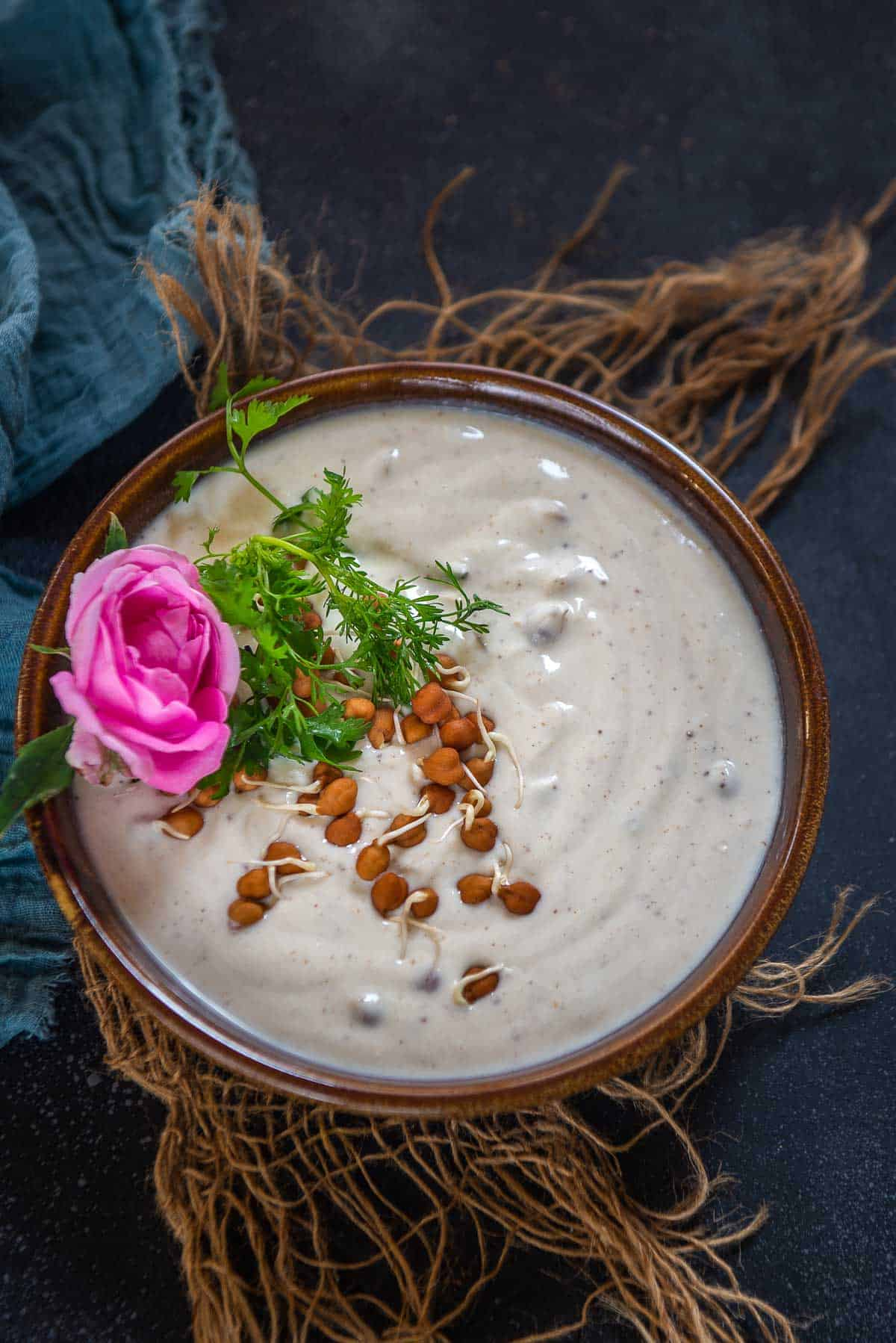 Sprouted chickpea raita served in a bowl.