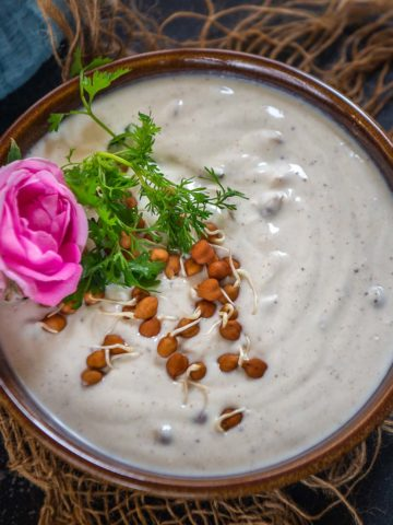 Bored of your usual raita recipes? Then try this sprouted chickpeas raita to serve with your Indian meals. It is easy, protein rich and perfect accompaniment for your summer meals. Here is how to make it.