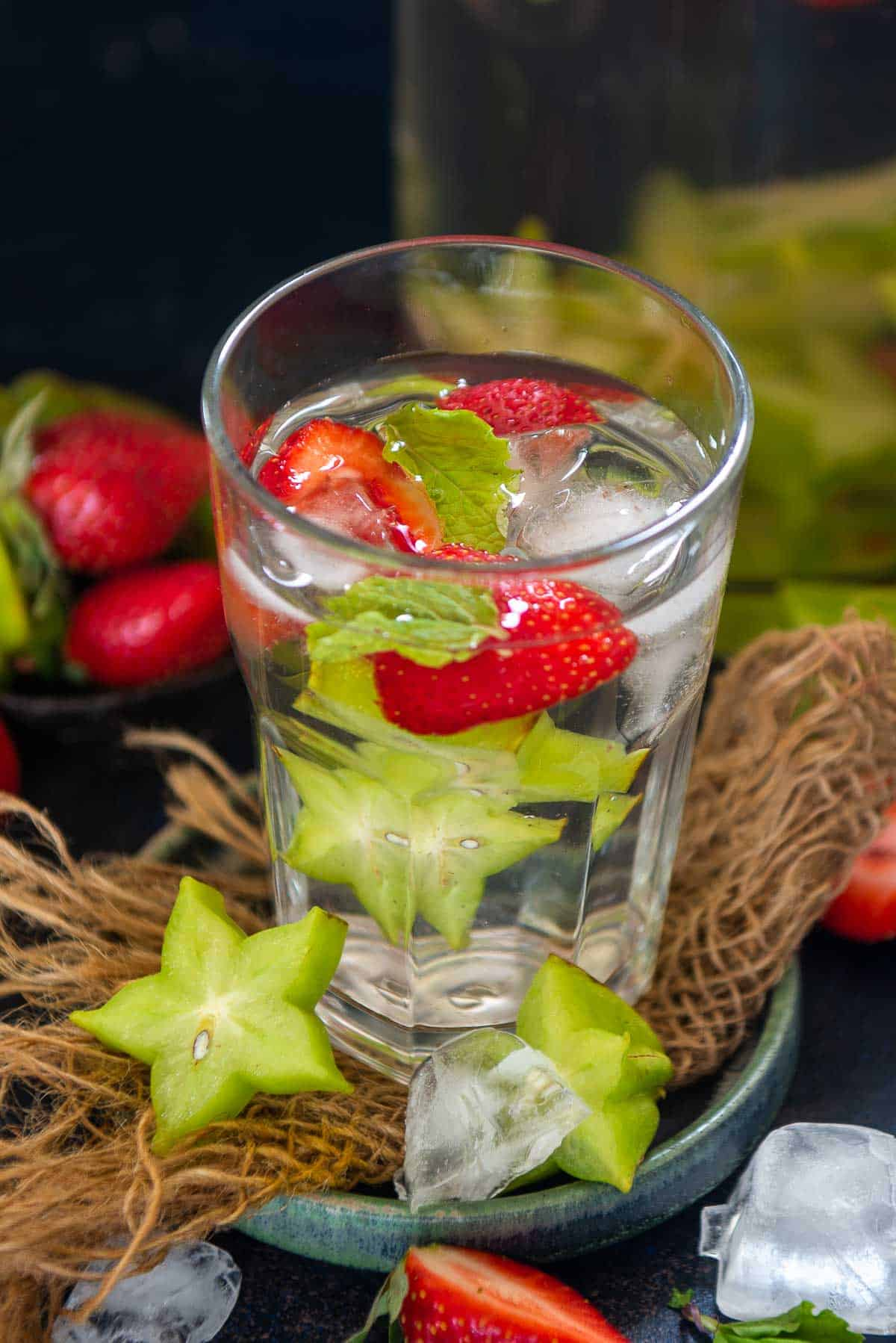 Starfruit detox water served in a glass.