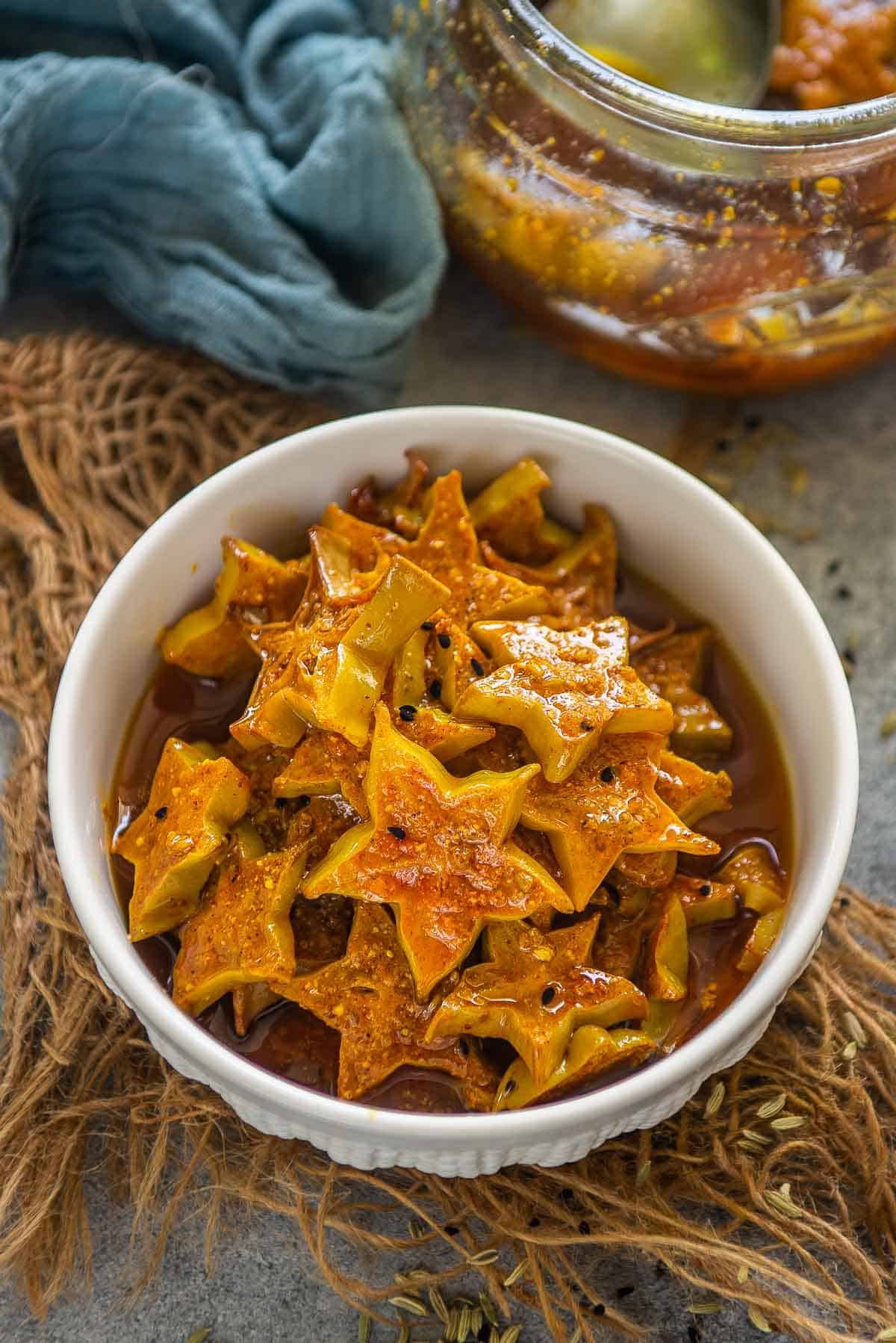 Starfruit pickle served in a bowl.