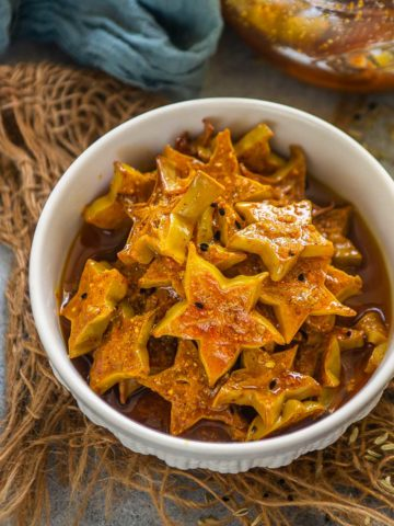 Starfruit Pickle is a different and unique Indian pickle recipe that you need to try this summer! It is just like your green mango pickle, but with the goodness of starfruit. It is easy, addictive, and requires a few basic pantry ingredients. Here is how to make it.