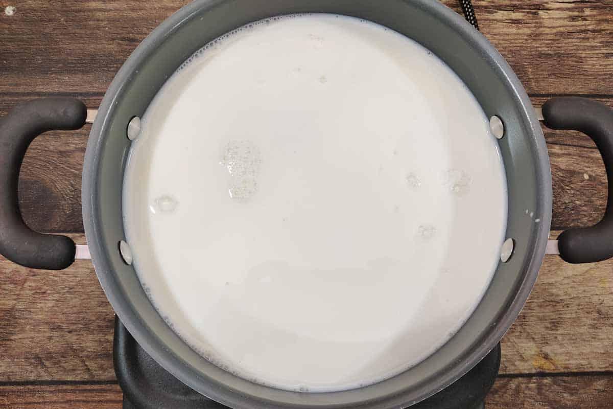 Milk heating in a pan.