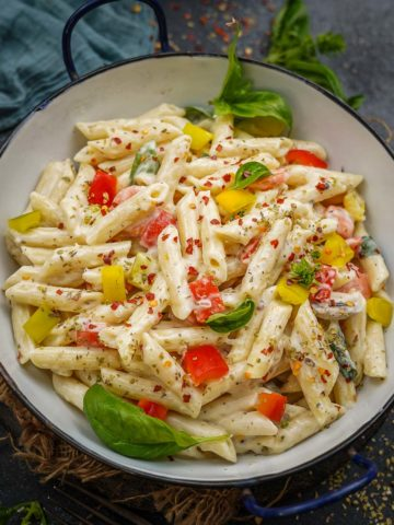Make this creamy white sauce pasta or bechamel sauce pasta from scratch in just 30 minutes. It makes for a perfect lazy dinner and is really popular among kids. Here is how to make it at home.