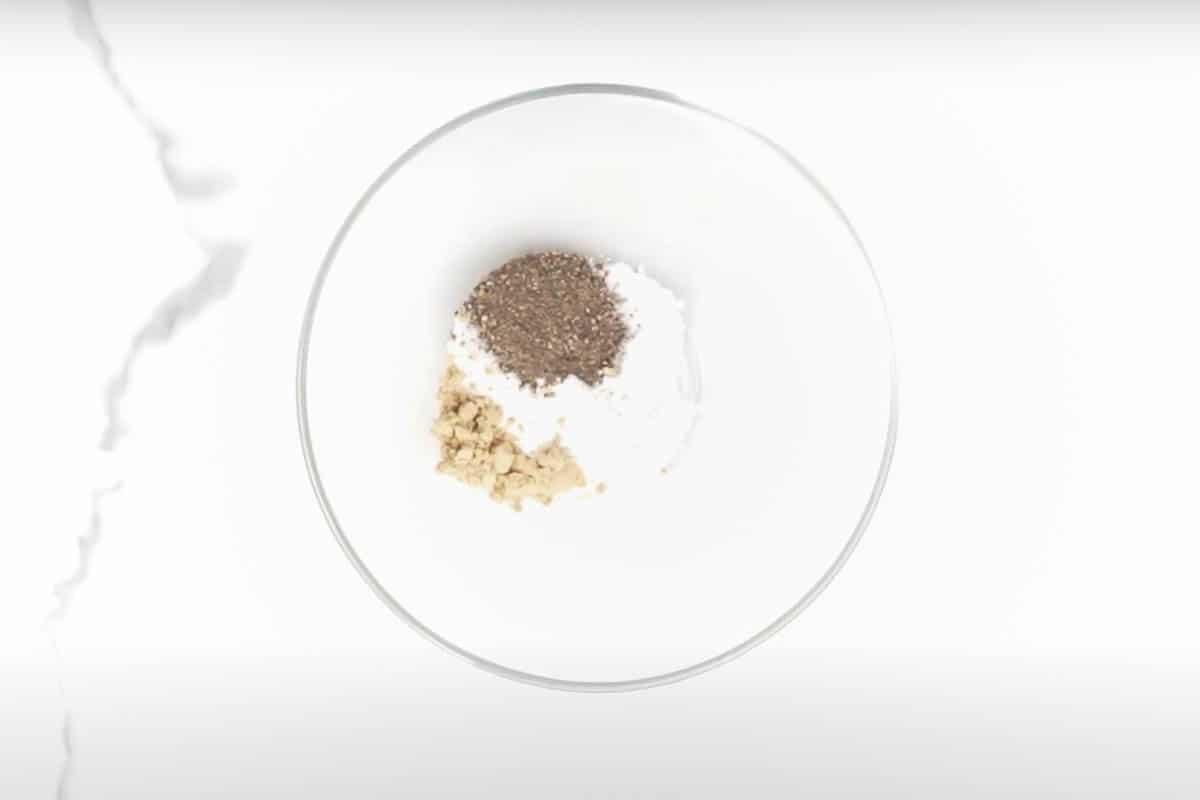 Flour, salt, pepper and garlic powder mixed in a bowl.