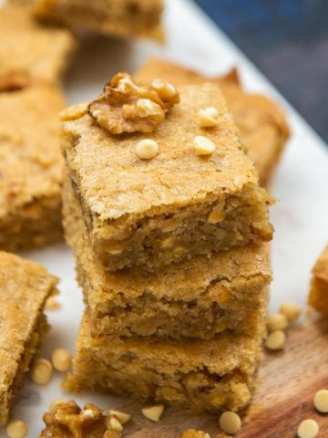 """These golden, soft, and chewy blonde brownies (blondies) will definitely make it to your """"favorite dessert list""""! No mixer required to make this super easy and simple recipe."""