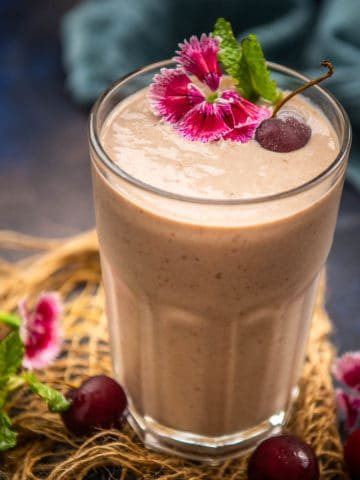 This cherry smoothie is packed with the goodness of frozen cherries, yogurt, and banana and comes together in just 5 minutes. Serve this creamy, delicious, kid's friendy smoothie for breakfast, snack, or as a dessert.