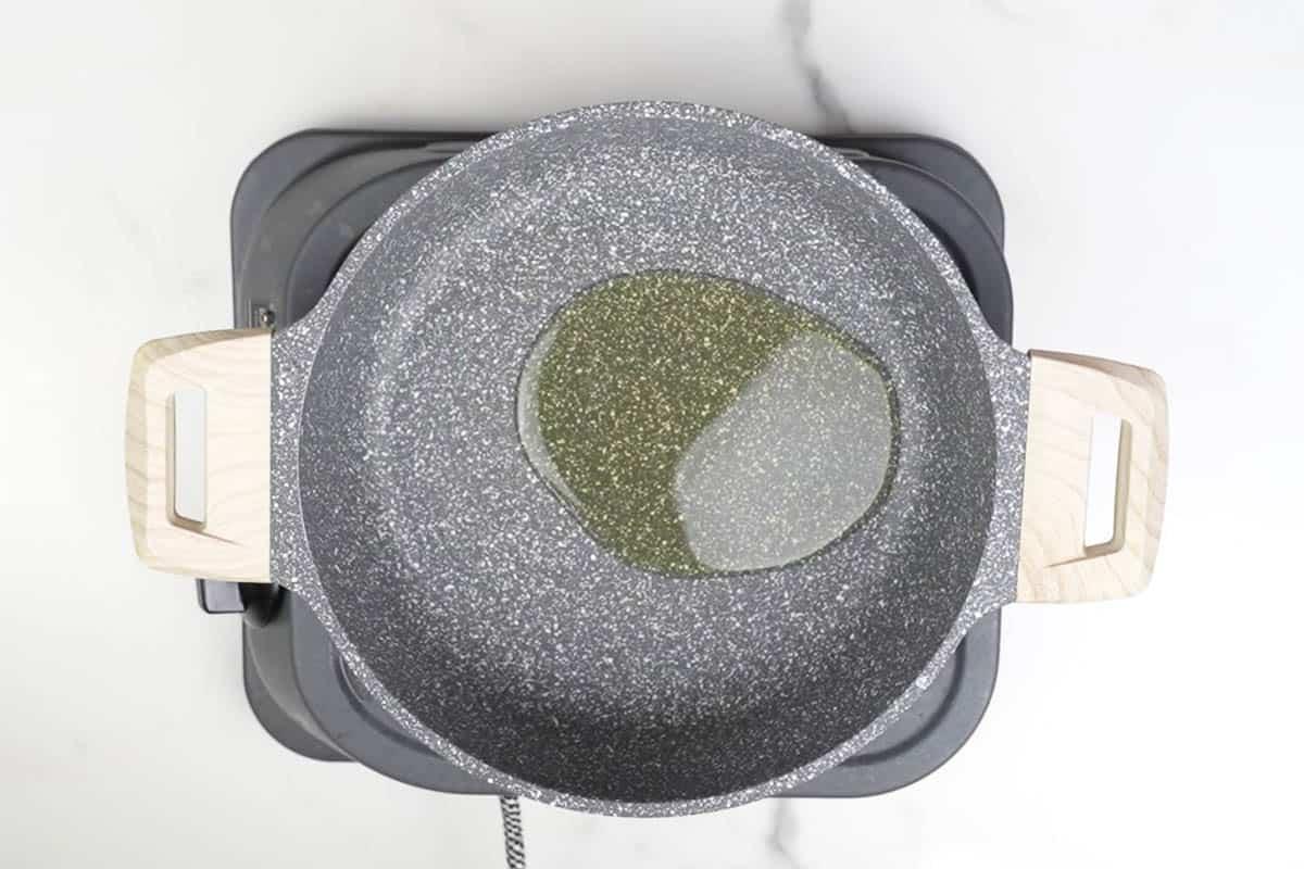Oil heating in a pan.