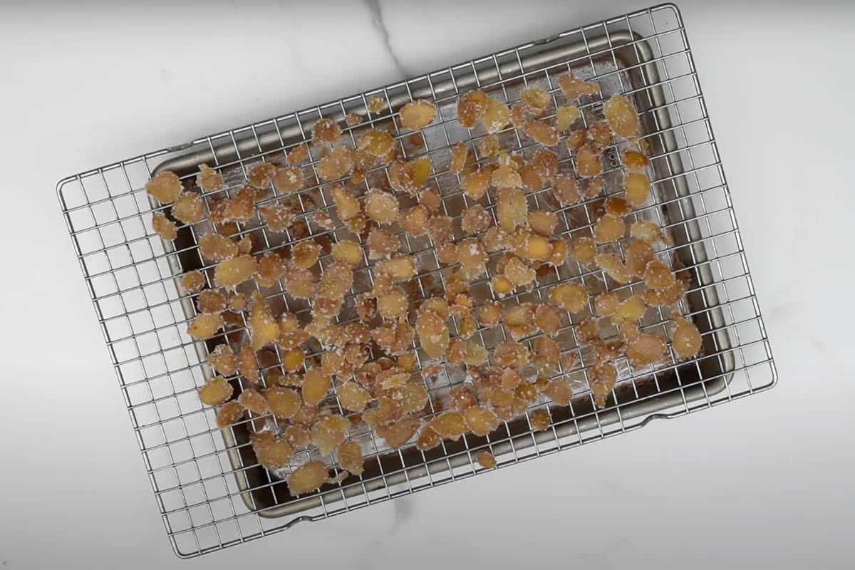 Ginger slices drying on a wire rack.