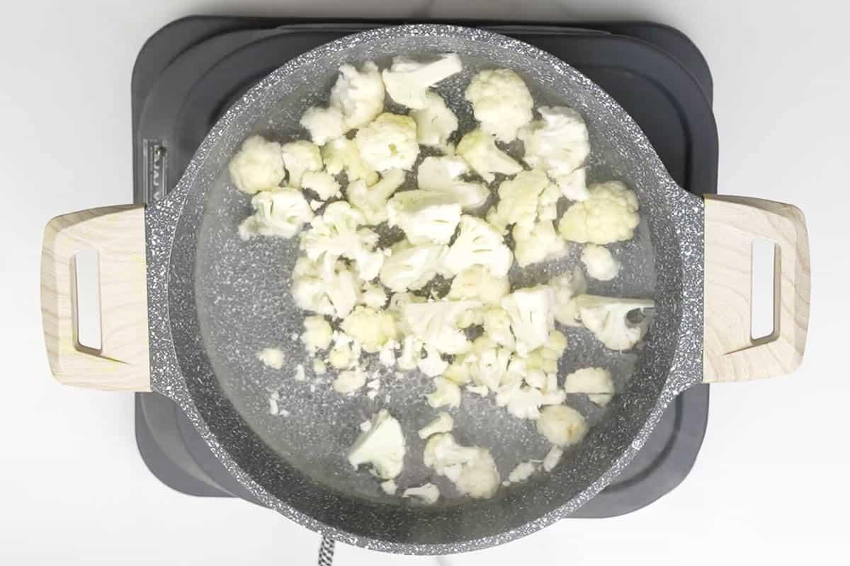 Cauliflower florets boiling in water