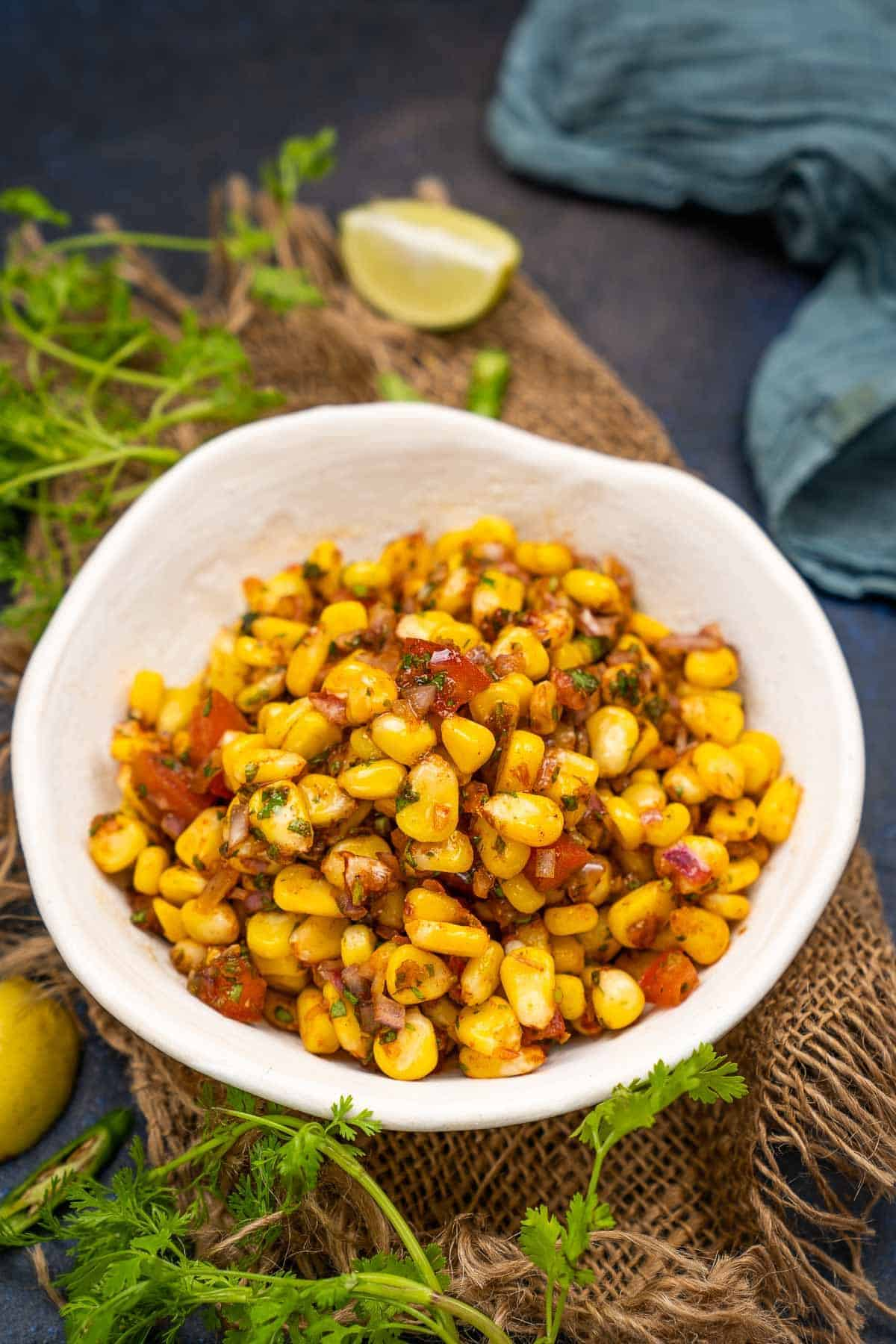 Indian flavored corn chaat served in a bowl.