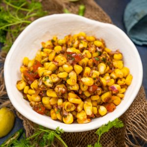 Corn Chaat is a spicy, tangy, and savory snack made using tender sweetcorn, onion, tomatoes, and a few herbs and spices. This super easy recipe comes together in under 15 minutes and is very healthy too.