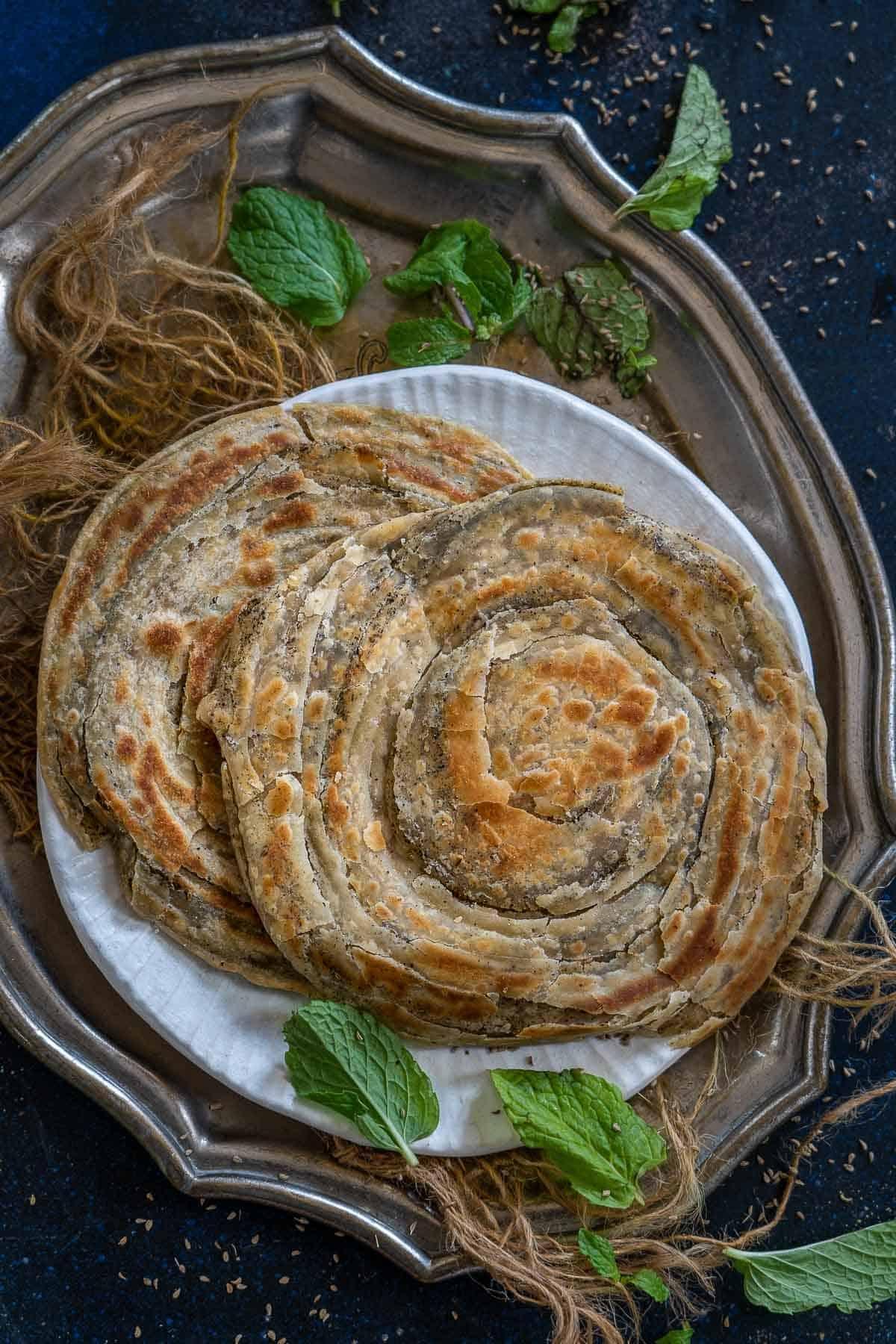 Mint Lachha paratha served on a plate.