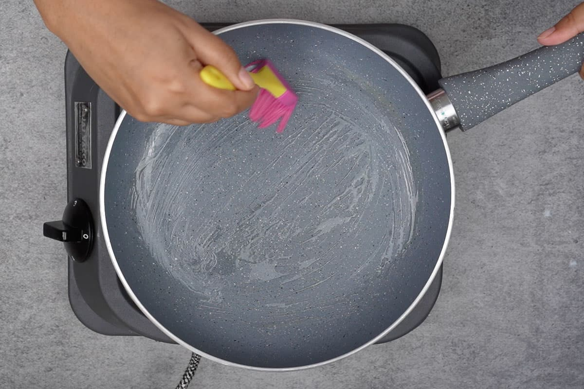 Non stick pan brushed with butter.