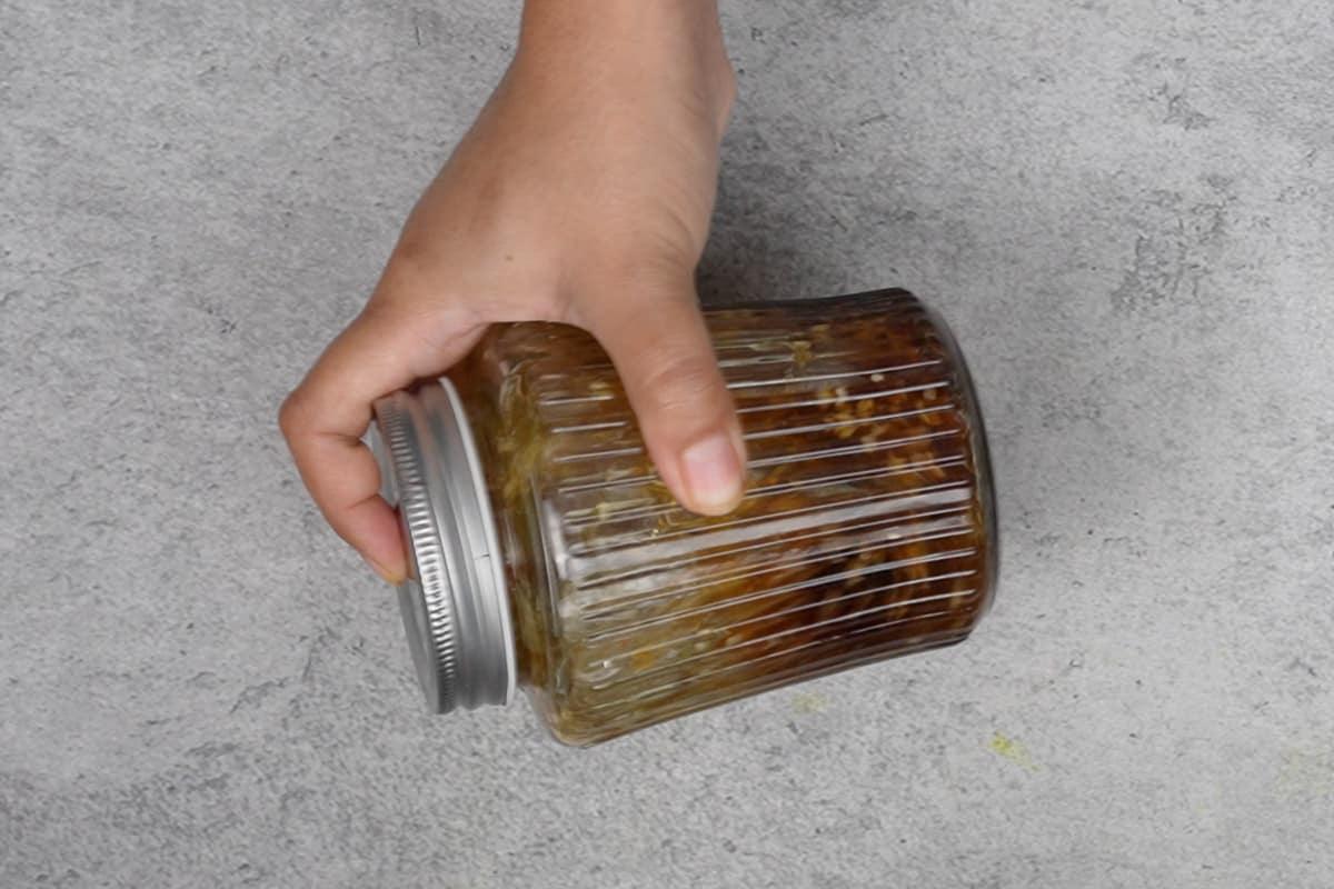 Shaking the jar vigorously.