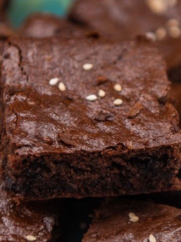 These chewy, fudgy and perfectly sweet chocolate tahini brownies are one of the best I have ever eaten. These are vegan, gluten-free, and paleo and have no butter, no flour, and no refined sugar.