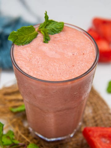 This 5-ingredient watermelon smoothie is super refreshing, juicy, and lightly sweet. Make it in under 5 minutes to up your summer smoothie game!