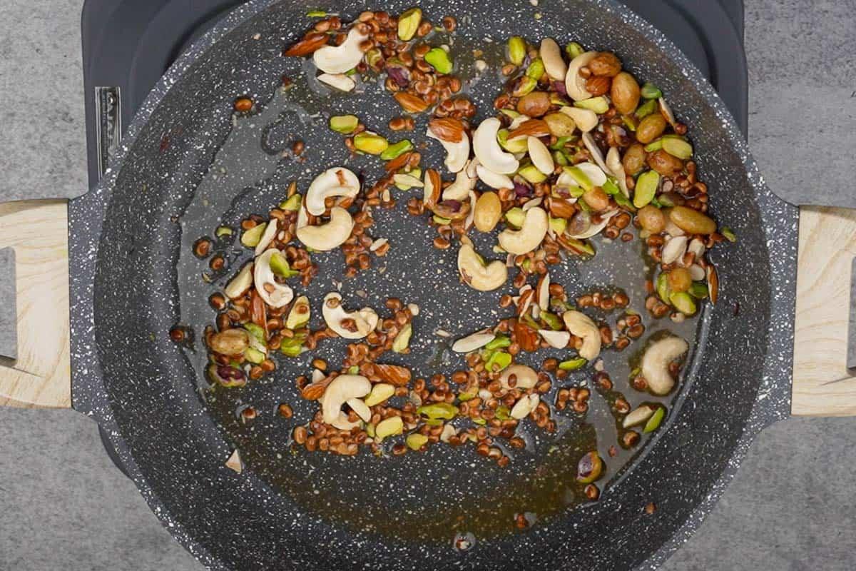 Nuts roasting in a pan.