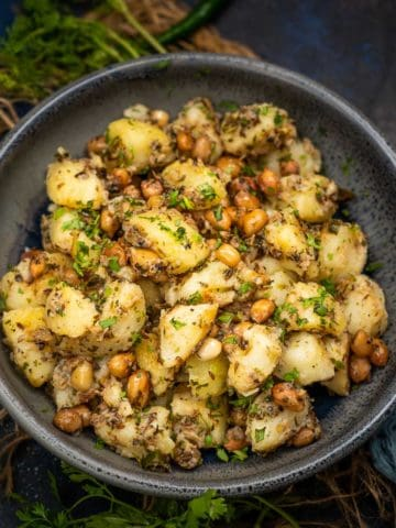 Vrat Wale Sookhe Aloo is a gluten-free dry sabji made using potatoes and peanuts. It is served as a snack on vrat (Hindu fasting) days. You can also serve it as a side dish with any Indian meal.