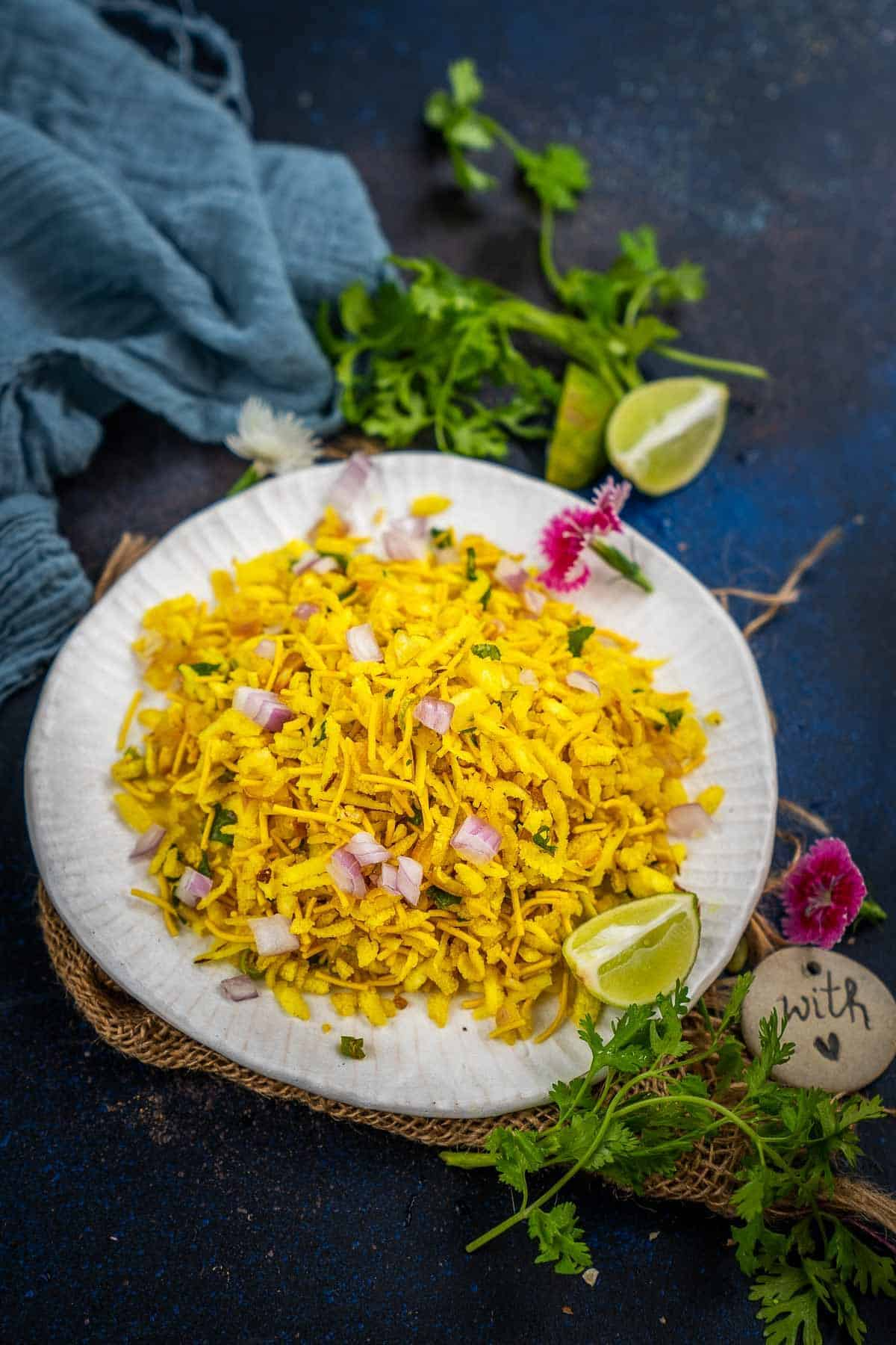 Poha bhel served on a plate.