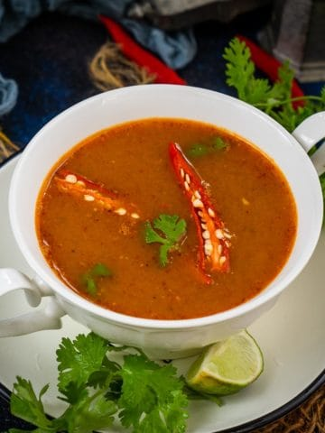 Make this velvety Thai pumpkin curry soup in under 20 minutes using simple ingredients. It is loaded with warm and cozy fall flavors and is super easy to make. This soup is naturally gluten-free, vegan, dairy-free and the recipe is very customizable.
