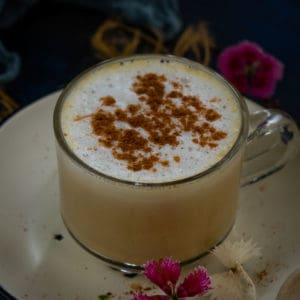 Pumpkin Spice Chai Tea is a delicious blend of milk, chai tea and real pumpkin puree with a hint of pumpkin pie spice. Try this Starbucks copycat drink this fall.