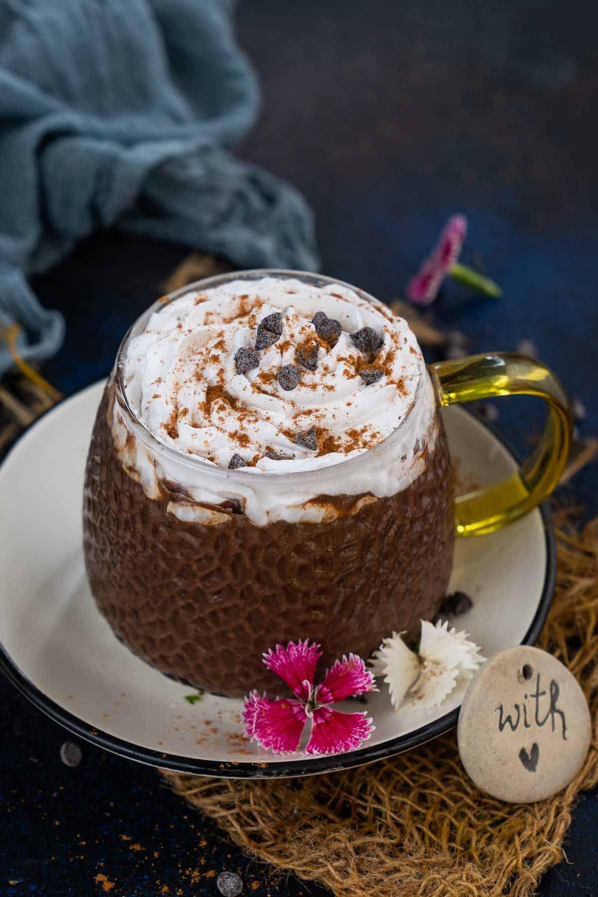Pumpkin spice hot chocolate served in a mug.