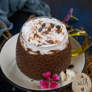 Pumpkin Spice Hot Chocolate is a delicious twist on classic hot chocolate. Loaded with warm and cozy fall flavors, it is rich and creamy and comes together in just 10 minutes. Here is how to make it.