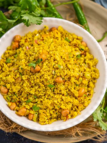 Millet Poha is a healthy take on the regular poha recipe where the poha (flattened rice) is replaced with flattened millet. It is perfect to serve for breakfast or evening snacks (vegan, gluten-free).