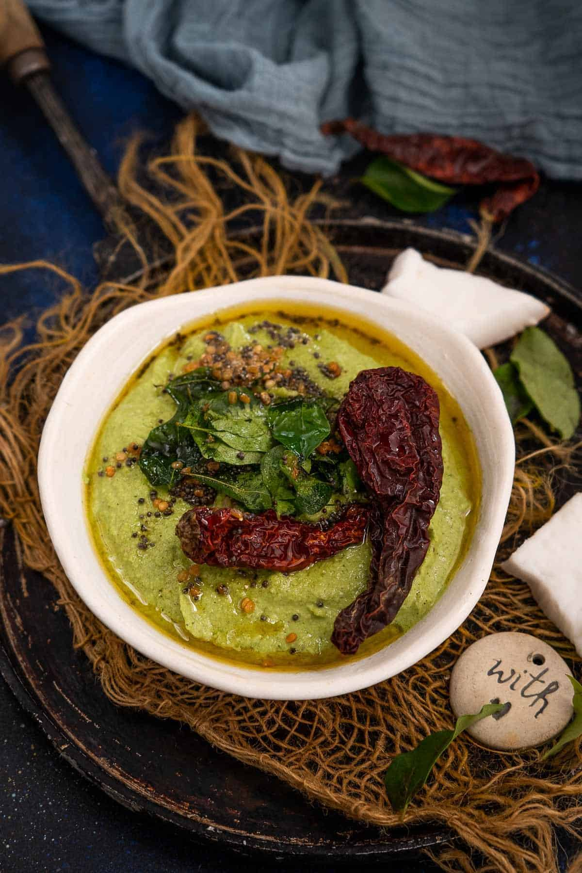 Mint coconut chutney served in a bowl.